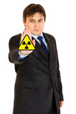 Radiation hazard! Businessman showing stop gesture Stock Photos