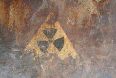Radiation hazard sign. On the rusty iron surface stock photos