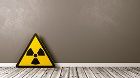 Radiation Hazard Symbol in a Room. Ionizing Radiation Hazard Symbol on Wooden Floor Against Grey Wall with Copyspace 3D Illustration Stock Photo