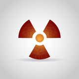 Radiation icon in polygonal style on a gray background Stock Images