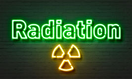 Radiation neon sign on brick wall background. Stock Photography