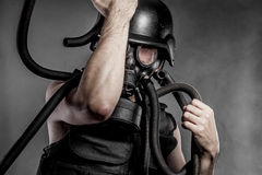 Radiation, nuclear disaster, man with gas mask, protection Stock Photos