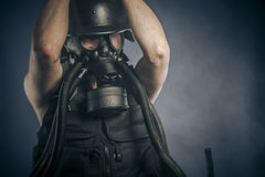 Radiation, nuclear disaster, man with gas mask, protection Royalty Free Stock Images