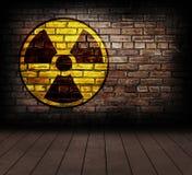 Radiation. Radiation sign on a brick wall royalty free stock photos