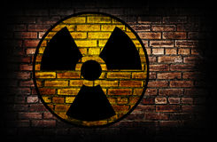 Radiation sign. Radiation sign on a brick wall Stock Images