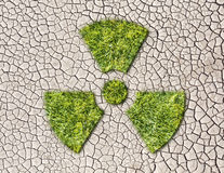 Radiation sign from grass  on cracked earth background Stock Photos