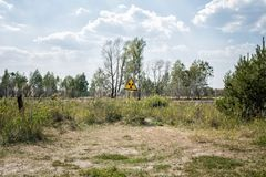 Radiation sign on a graveyard in abandoned Pripyat city royalty free stock photos