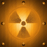 Radiation sign on metal surface effect background Stock Photos