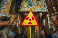 Radiation Sign - triangular warning yellow sign of radiation hazard in the zone of radioactive fallout in Pripyat city stock photo