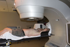 Radiation Therapy Treatment. Patient Radiation therapy showing laser lines for targeting cancer cells in the brain and Throat royalty free stock image