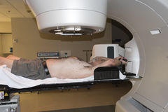 Radiation Therapy Treatment. Patient Radiation therapy showing laser lines for targeting cancer cells in the brain and Throat stock images