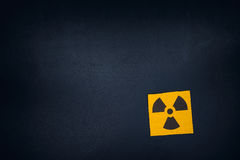 Radiation warning sign on a blackboard Royalty Free Stock Images