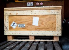 Free Radiation Warning Sign Transport Label Class 7 On The Dangerous Goods Package Type A In The Container Of Transport Truck Royalty Free Stock Images - 138957189