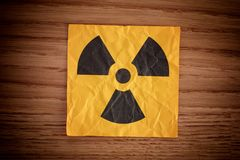 Radiation warning sign on a wooden board royalty free stock images