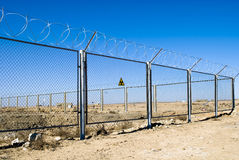 Radiation zone. (protection with a barbed wire Royalty Free Stock Photo