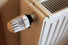 Radiator. Control knob of a standard radiator is set to highest level stock images