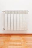 Radiator. Modern radiator on wall -source of heat Stock Image