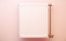 Radiator. On pink wall background Stock Photography