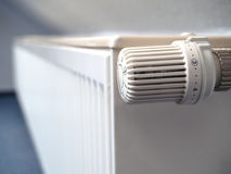 Radiator. The picture shows a white radiator with a thermostat Stock Image