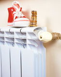 Radiator adjustment to save energy. Save energy and money concept Royalty Free Stock Photos
