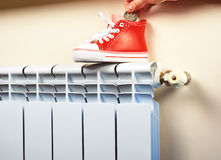 Radiator adjustment to save energy. Save energy and money concept Royalty Free Stock Images