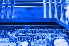 Radiator on chip of northbridge of computer motherboard close macro Stock Photos