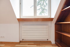 Radiator in cozy room. With wooden elements royalty free stock photography