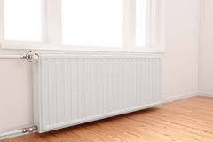 Radiator in empty room. Central heating radiator conceptual of increasing costs of energy Royalty Free Stock Photography