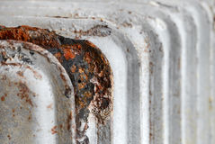 Radiator fins. Rusty household cast iron radiator fins Royalty Free Stock Images