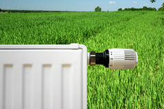 Radiator on a green field Royalty Free Stock Images