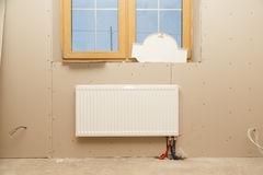 Radiator heating in the room without finishing during construction Stock Image