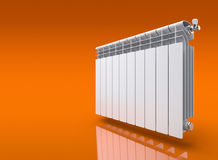 Radiator on orange reflective background Royalty Free Stock Images