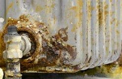 Radiator. Rusty household cast iron radiator Stock Photo