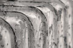 Radiator. Rusty household cast iron radiator fins Stock Photos