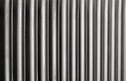 Radiator. Rusty household cast iron radiator fins Stock Image