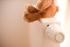 Radiator and teddy bear Stock Photo