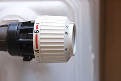 Radiator thermostat. Details of a  closed cold radiator thermostat Royalty Free Stock Images
