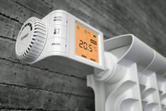 Radiator thermostat controller on heater. Closeup. Royalty Free Stock Images