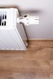 Radiator with thermostat in home interior Stock Images