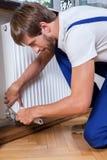Radiatore della riparazione a casa Immagini Stock