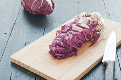 Radicchio di Treviso red cut on a wooden cutting board. Italy Stock Images