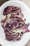 Radicchio. Grilling radicchio chicory on a barbecue grill. Horizontal Royalty Free Stock Photo