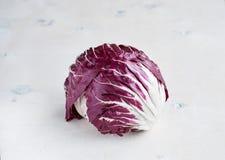 Radicchio red salad on wooden background. Horisontal Royalty Free Stock Image