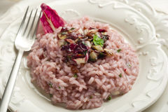Radicchio risotto. With fork on dish Royalty Free Stock Photos