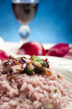 Radicchio risotto. With fork on dish and red wine close up Royalty Free Stock Photo