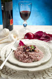 Radicchio risotto. With fork on dish and red wine Royalty Free Stock Photos
