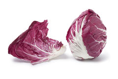 Radicchio rosso. And a leaf on white background Royalty Free Stock Photos