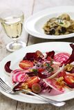Radicchio rosso salad and fresh porcini risotto. Radicchio rosso salad and fresh porcini mushroom risotto Stock Images