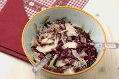 Radicchio salad, walnuts, pears and flaked Parmesan Royalty Free Stock Photography