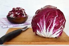 Radicchio on wooden board Royalty Free Stock Photography